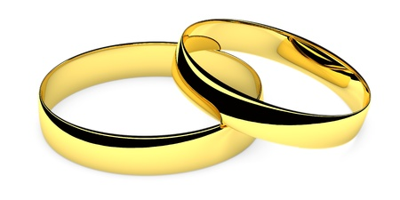 Two lying golden wedding rings isolated on white background photo