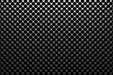 Steel grid with round holes and reflection on black background under the top straight light, abstract textured background photo