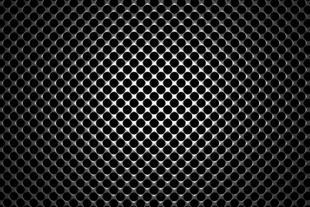 Steel grid with round holes and reflection on black background under the round central light, abstract textured background photo