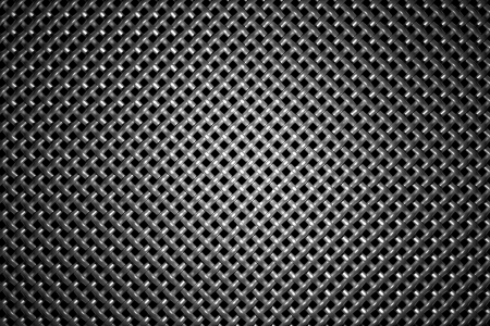 diagonally: Braided diagonally oriented wire steel grid with reflection on black background under the round central light, abstract textured background Stock Photo
