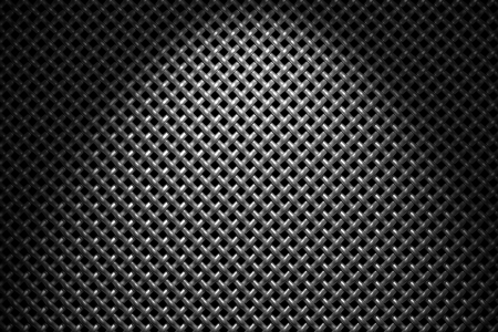 diagonally: Braided diagonally oriented wire steel grid with reflections on black background under the spot light, abstract textured background