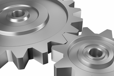 industrial and business processing and working concept: two steel interlocking cogwheels on downward diagonal over isolated white background Stock Photo