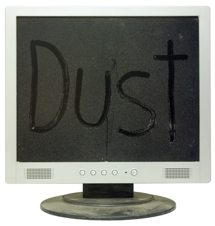 Dirty LCD monitor under a thick layer of dust on the white background Stock Photo