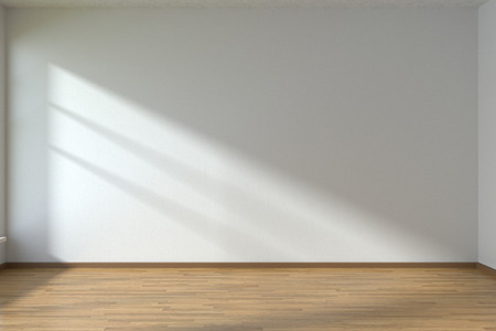 Empty room with white walls and wooden parquet floor under sun light through window Zdjęcie Seryjne