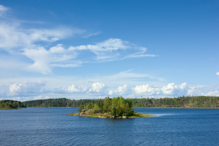 Ladoga lake with small island under summer sunset light panoramic view photo