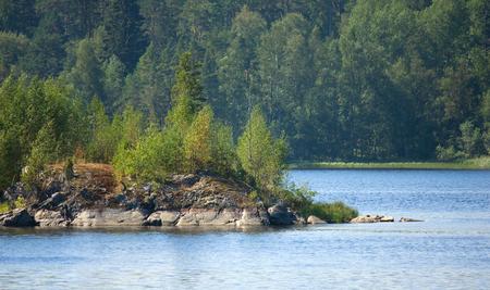 ladoga: Ladoga lake with island under summer sun light close-up view Stock Photo