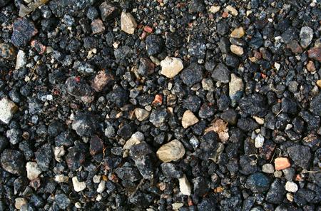 macadam: Black dirty broken stones background, macadam