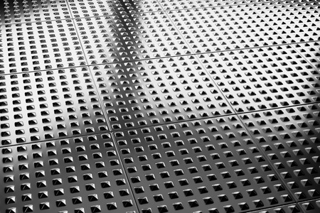 coating: Abstract industrial creative metal construction monochrome illustration: industrial steel flooring metal surface closeup under bright lights, industrial 3d illustration Stock Photo
