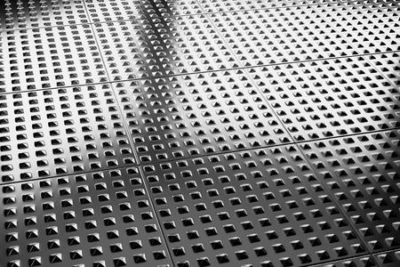 flooring: Abstract industrial creative metal construction monochrome illustration: industrial steel flooring metal surface closeup under bright lights, industrial 3d illustration Stock Photo