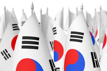 Many small flags of South Korea republic isolated on white background, 3d illustration, selective focus, shallow depth of field