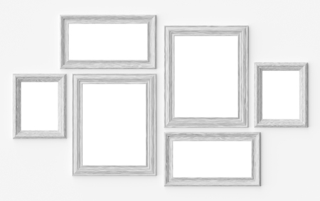 White wooden blank picture or photo frames on white wall with shadows with copy-space, decorative wooden picture frames template set, art frame mock-up 3D illustration