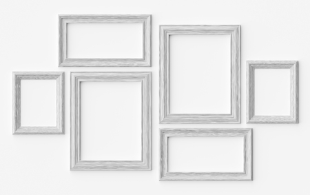 White wooden blank picture or photo frames on white wall with shadows, decorative wooden picture frames template set, art frame mock-up 3D illustration