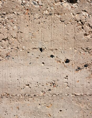 Gray concrete aged rough bumpy weathered old wall surface industrial background.