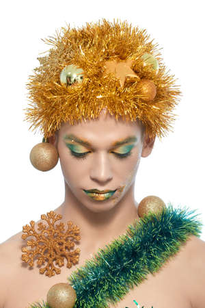 young man portrait: Portrait of a man decorated with Christmas decorations. Stock Photo