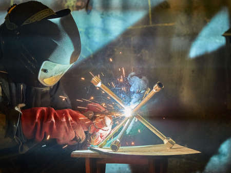 Welder working with automatic welding Stock Photo
