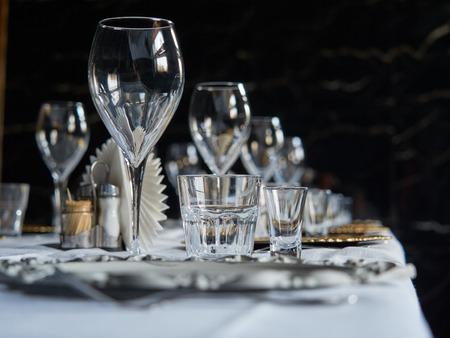 Various glass glasses are set on the table in the restaurant. Reklamní fotografie