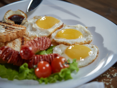 Fried eggs with sausage. Standard-Bild - 120540993