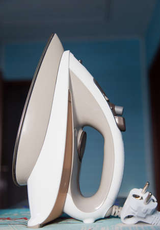 Iron close up on ironing board