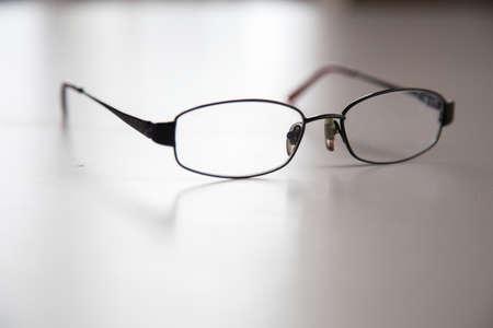images of black glasses frame on a white table