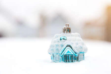 dwelling: Toy snow-covered house. Christmas tree toy. brilliant blue house. New Year. Stock Photo