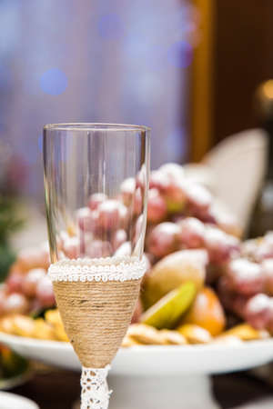 A vintage glass of champagne on a festive table