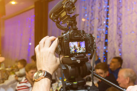 Wedding recording with the camera.Selective focus on the camera.