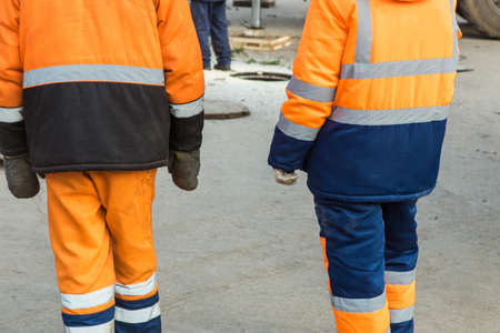 bright overalls of city service workers close up.