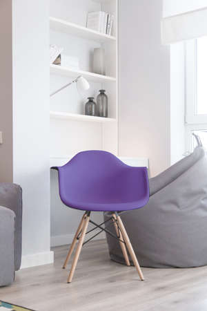 Interior of the room in light colors and a chair in color in 2018, ultra violet.