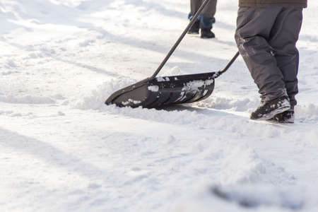 man with shovel cleans the snow