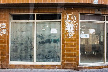 Dubai, UAE February 19, 2018:The dusty painted window of an abandoned shop window Editorial