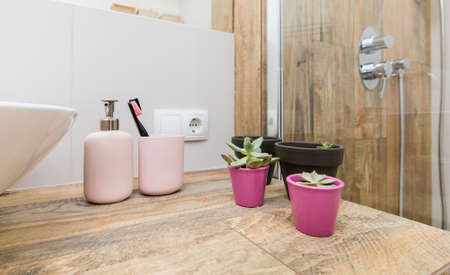 Bathroom accessories Shampoos, bottles and other hygiene items in the interior of a modern bathroom