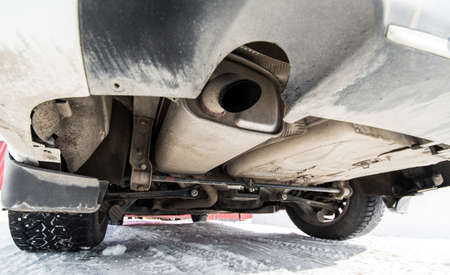 Under the car. Wheels, exhaust system and suspension