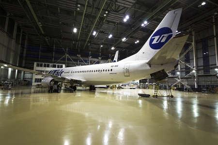 Ufa, Russia. May 19, 2018: Passenger airplane Utair airline on maintenance of engine and fuselage repair in airport hangar