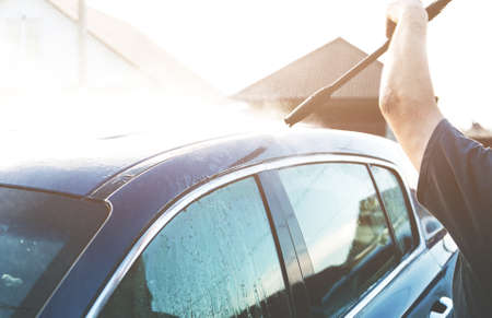 Manual car wash with pressurized water in car wash outside. professional washing machines and cleaning