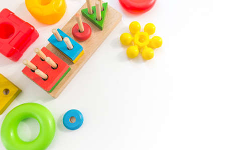 Many colorful Kids toys frame on white background. Top view. Flat lay. Copy space for text