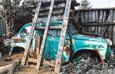 blue vintage old broken car.