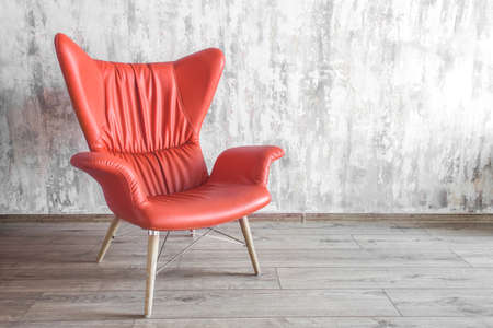 armchair chair in the interior. color of the year 2019 Living coral Banco de Imagens - 113842835