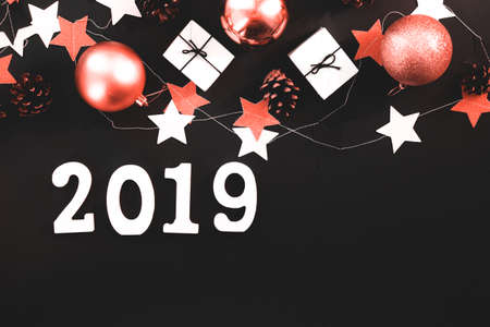 Happy New Year's layout. numbers 2019 notepad and free space for text. Christmas decorations , Color of the year 2019 living coral. livingcoral Stock Photo