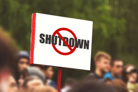 Government Shutdown USA concept with American flag . protest.