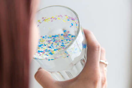 girl drinks polluted water microplastic