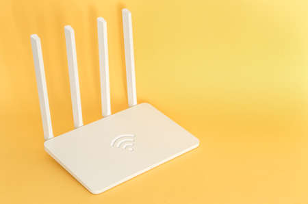 White wifi router on a yellow 스톡 콘텐츠