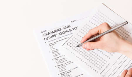Test of English multiple choice on table.Woman takes an entrance exam.