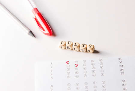 Test of English multiple choice on table. Woman takes an entrance exam. Stock Photo