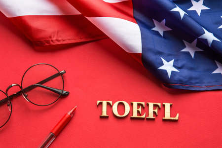 Test of English multiple choice on table. Top view, flatlay, American flag. Stock Photo