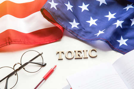 Test of English multiple choice on table. Top view, flatlay, American flag. Banco de Imagens