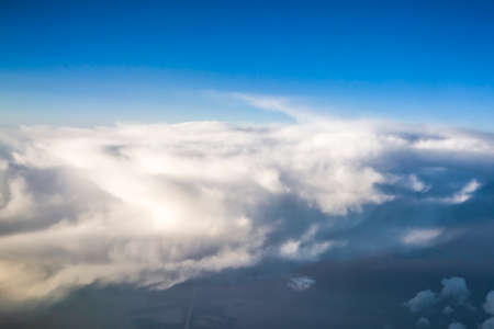 Blue sky with white clouds during the afternoon. view from the airplane's illuminator. copy space for text