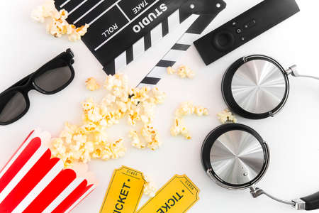 Cinema party concept. movie tickets, clapperboard, pop corn and 3d glasses in a white