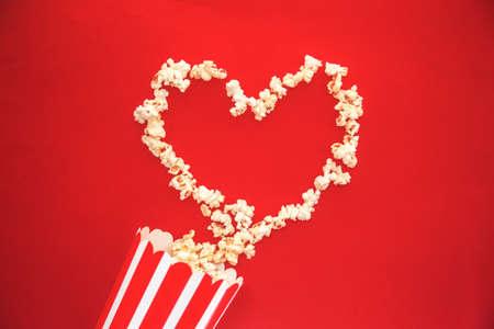 Cinema party concept. Love pop corn in a red Banco de Imagens