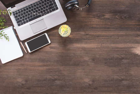 Top view of hipster wooden workspace, office table desk Banco de Imagens