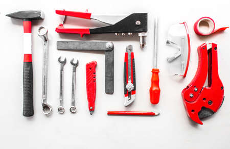 Set of carpentry red tools on wood Banco de Imagens